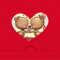 Rödfolierat hjärta med Nallar som pussas